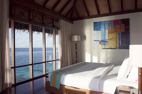 Ausblick von der Escape Wasser Villa auf der Insel Coco Bodu Hiti, Nord Male Atoll